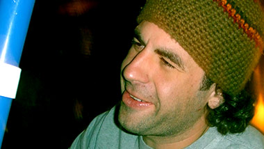 Webster in hand knitted beanie and longster hair