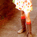 a girl's knees and boots